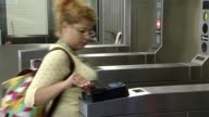 People Scanning Ventra Transit Card At Turnstile on October 09 2013 in Chicago Illinois