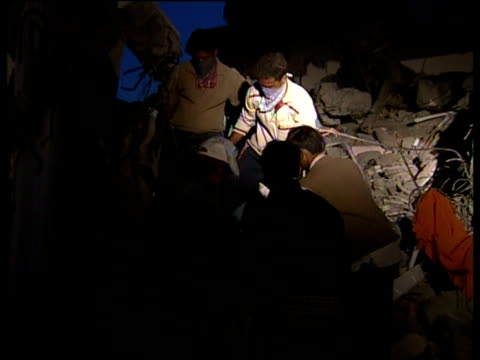 People search rubble for survivors of the Gujarat earthquake