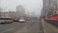 People seen amid a heavy haze in Beijing China on November 28 2015 Air quality reached extremely hazardous levels The World Health Organization...