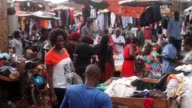 People selling and buying products in market in Kampala