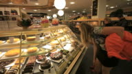 People shopping at KaDeWe food department store-Cakes and delicacies from all over the world, Berlin
