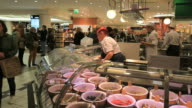 People shopping at KaDeWe food department store-delicacies from all over the world