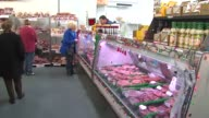 People Shopping At Meat Counter at Whittingham Meats on December 26 2013 in Chicago Illinois