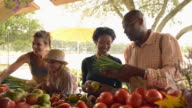 People shopping for produce at farm stand