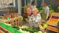 HD DOLLY: People Shopping In Greengrocer'S Shop