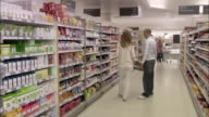 WS People shopping in supermarket / North Finchley, London, UK