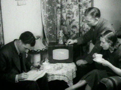 People sit around a wireless listening to the 1951 General Election results 25 October 1951