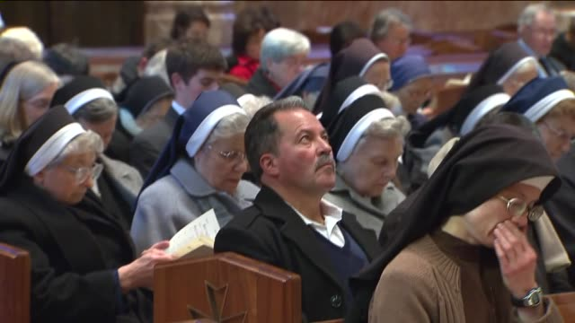 WGN People sit on pews and sing at prayer service on first full day of Blase Cupich as new Chicago Archbishop on Nov 19 2014 in Chicago