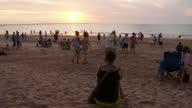 WS People sitting at Mindil beach at sunset / Darwin, Northern Territory, Australia