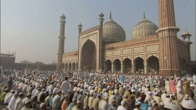 WS People sitting in vast courtyard of mosque /Delhi, National Territory of Delhi, India