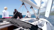 WS People Sitting On A Deck Of Sailboat