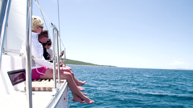 WS People Sitting On A Sailboat