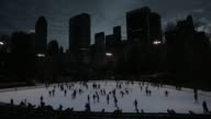 People skate at the Wollman Ice Skating Rink in Central Park at night on February 2 A time lapse shot of people ice skating at the Wollman rink at...