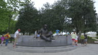People stand by the statue of Albert Einstein in the grounds of the National Academy of Sciences.