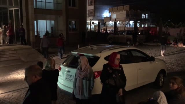 People stand in the street after a 73 magnitude earthquake in Erbil Iraq on November 12 2017 An earthquake measuring 73 on the Richter scale rocked...