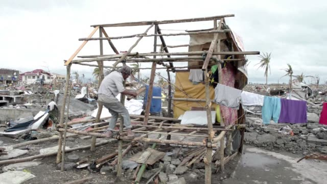 People start the long task of rebuilding their homes after super Typhoon Haiyan devastated the central Philippines CLEAN People start the long task...
