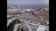 MONTAGE People swim and sunbathe at a modern style beach in Yemen / Aden, Yemen