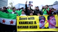 People take part in a demonstration to protest Assad regime forces' and its supporters' attacks on civilians and the humanitarian plight in Aleppo in...