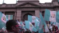 People take part in a protest in Guatemala City demanding the resignation of congressmen