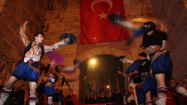 People take part in a torchlight procession on the eve of the Republic Day celebrations marking the 94th anniversary of the founding of the Turkish...