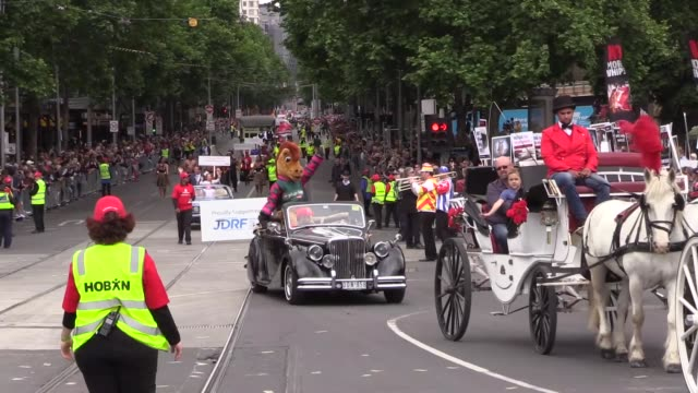 People take part in the 2017 Melbourne Cup Parade as a group of activists stage a protest on November 6 2017 in Melbourne Australia Victoria Racing...