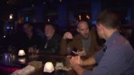 People Talking At A Bar at Sidetrack on November 20 2013 in Chicago Illinois