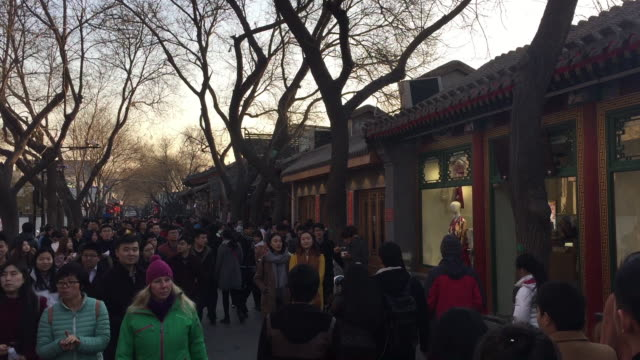 People tour in Hutong Alley on Feb 9 2017 at famous Houhai area in Beijing China