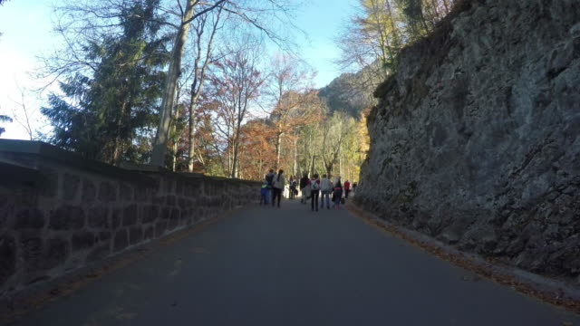 People Tourism walking up and down on Neuschwanstein castle.