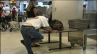People traveling at Midway Airport on Feb 1 2002 in Chicago Illinois
