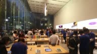 People try out Apple Inc iPhone 6 and iPhone 6 Plus at the company's Omotesando store in Tokyo Japan Close up shot of the Apple Logo above the store...