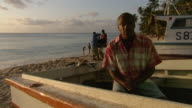 MS People trying to operate the boat  / Brightown, Barbados