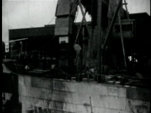 1929 B/W MONTAGE People unloading bananas from ship in port / New Orleans, Louisiana