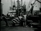 1929 B/W MONTAGE People unloading sacks of grain from ship in port / New Orleans, Louisiana