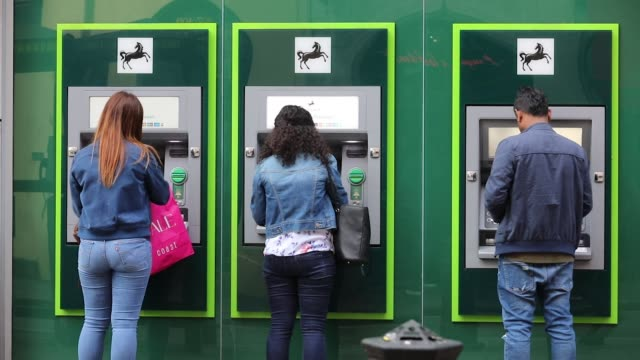 People use automated teller machines outside a Lloyds bank branch a unit of Lloyds Banking Group Plc in London UK on Wednesday May 31 2017