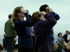 People use eye protection lenses to witness the total eclipse