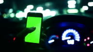 People using a smartphone on car ,green screen