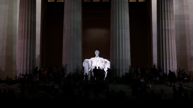 People using flash photography at lincoln memorial at night