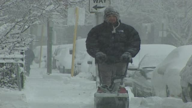 People Using Snowblower In Snow Storm on December 11 2000 in Chicago Illinois