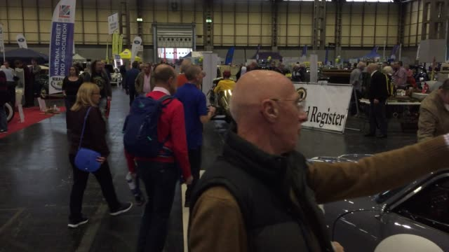 People view some of the classic cars that are being displayed on the first day of the Lancaster Classic Motor Show at the NEC Birmingham on November...