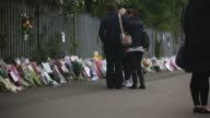 LS People view tributes to slain teacher Anne Maguire outside Corpus Christi Catholic College in Neville Road on April 30 2014 in Leeds England A...