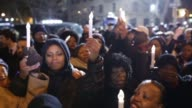 People visit the memorial at the corner Tompkins Ave and Myrtle Ave on December 21 2014 in New York near the site where two New York City police...