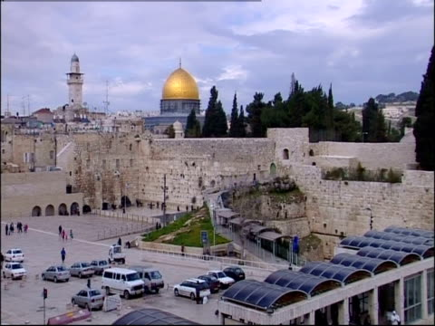 People visit the Western Wall near the Dome of the Rock in Jerusalem.
