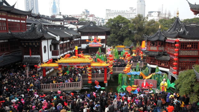 People visiting Yuyuan Garden and shopping area at chinese new year, Shanghai, China, Asia