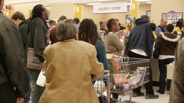 People wait in long lines at the grocery store on October 28 2012 in Washington DC