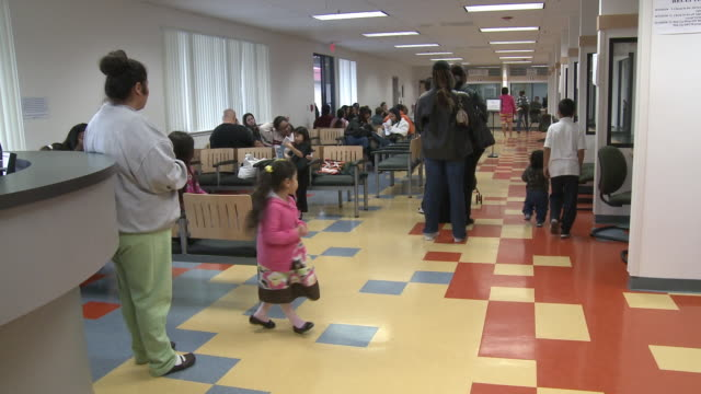 People waiting in line and children playing in job center office/ Antioch Calfornia USA/ AUDIO