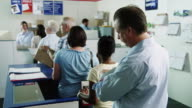 MS People waiting in line at post office / Orem, Utah, USA