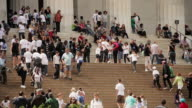 People walk along stairs in front of the Jefferson Memorial.