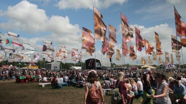 People walk around the site at the Glastonbury Festival at Worthy Farm Pilton on June 27 2015 in Glastonbury England