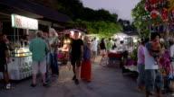 People walk at night market