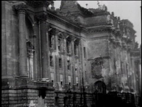 WS people walk near Reichstag in Berlin / WS Russian troops in Berlin the Brandenburg Gate in background / Berlin Germany